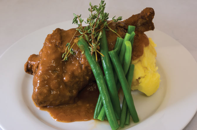 Slow cooker lamb shanks with red wine sauce served on potato mash with ...